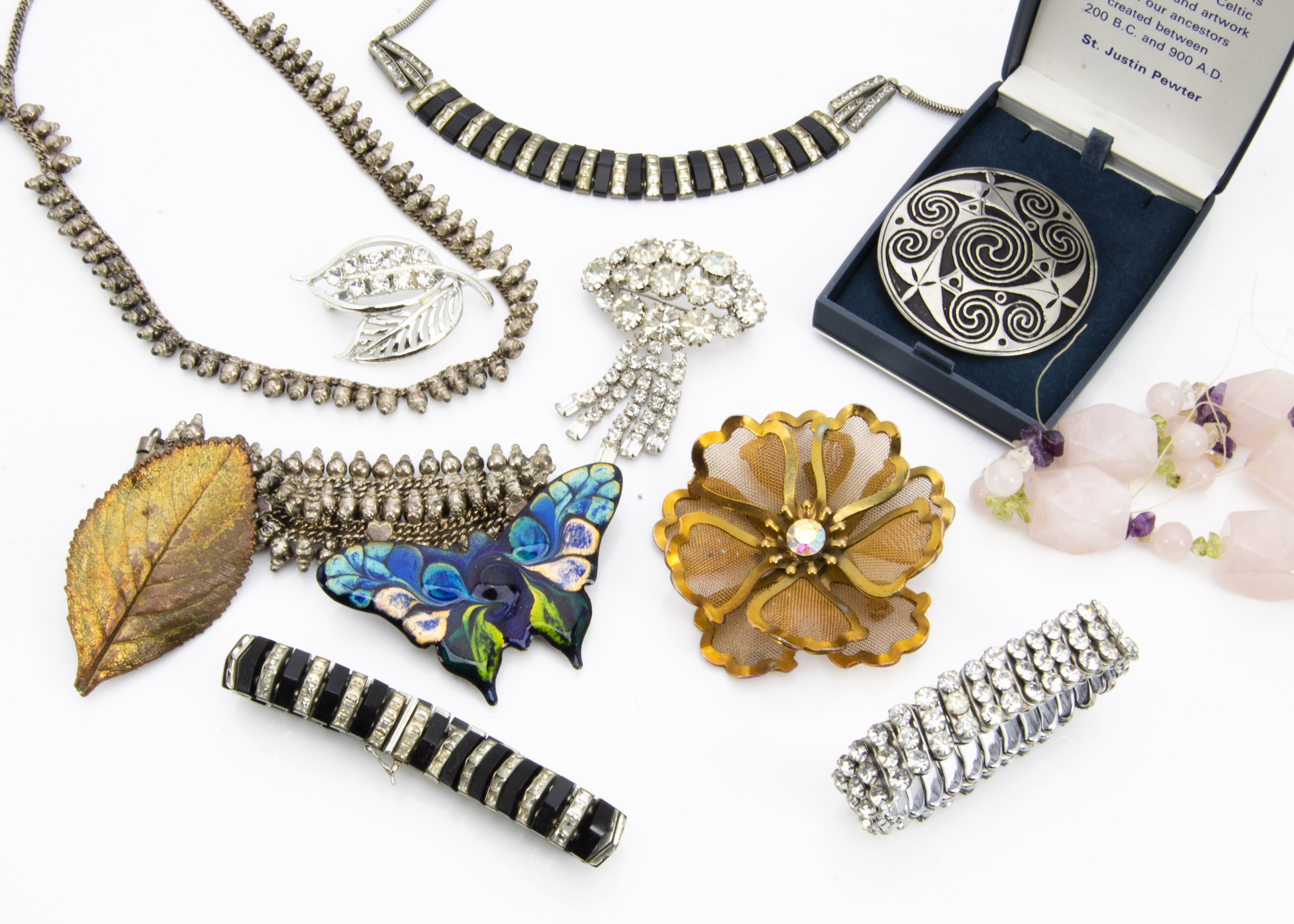 Lot 258 - A collection of costume jewellery, including an Art Deco marked necklace and matching bracelet, a