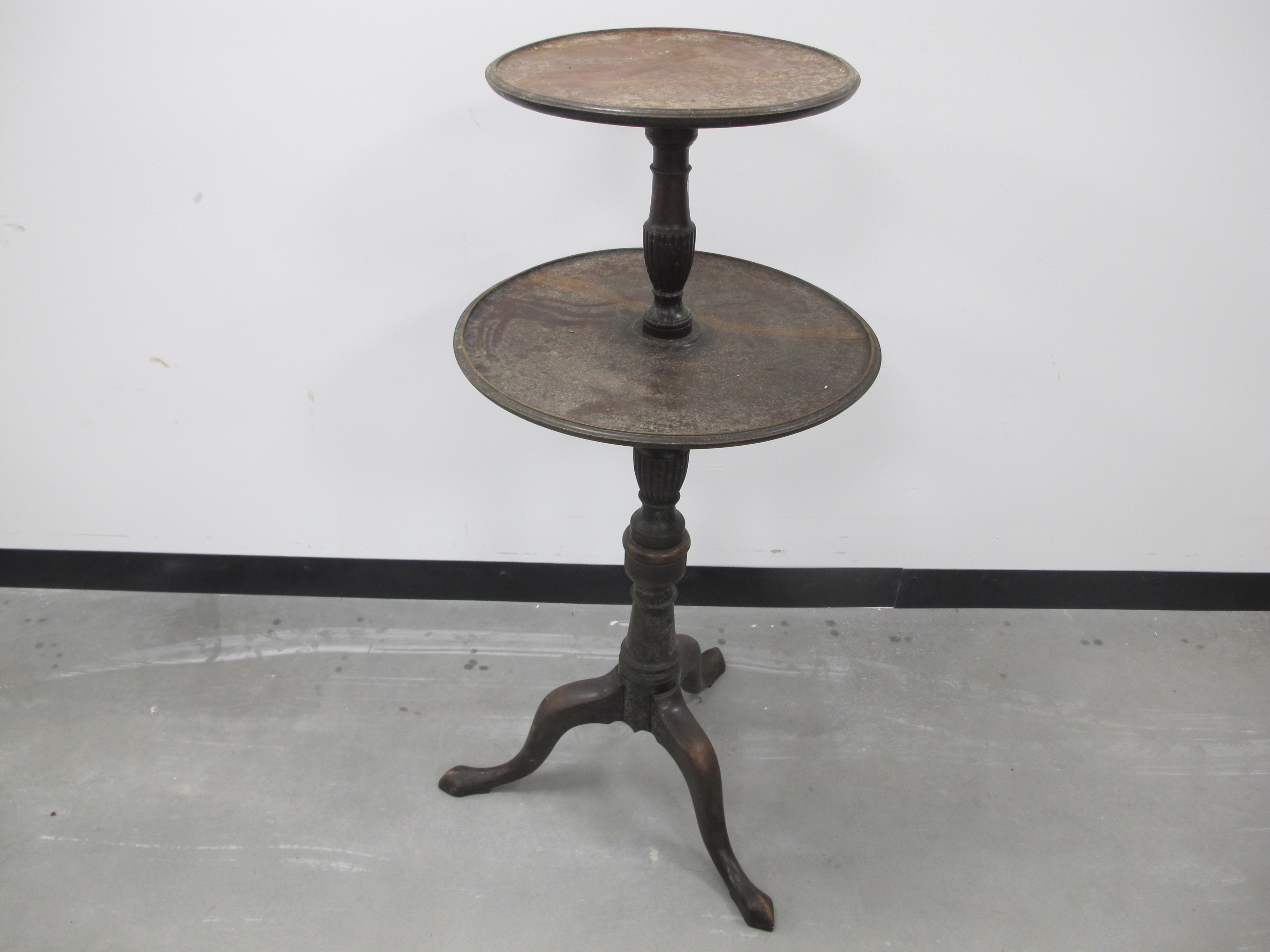 Lot 446 - A 19th Century mahogany two tiered circular dumb waiter, with turned and fluted column, raised on