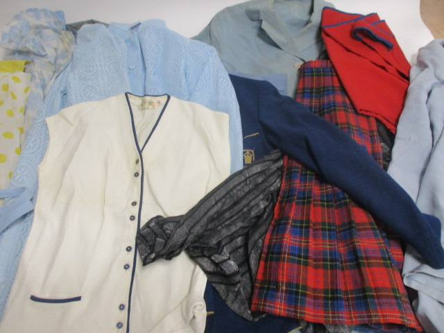 Lot 22 - A collection of ladies vintage clothing, including a blue cotton Quelrayn coat, a Jaeger coat, skirt
