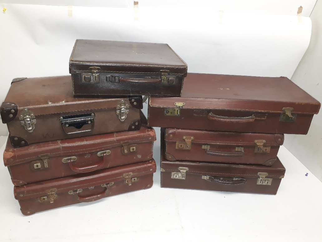 Lot 181 - 1930s and Later Small Suitcases, a group of seven brown cases including a leather example initialled