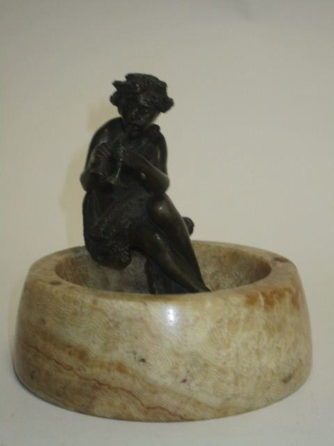 Lot 143 - An early 20th Century bronze study of a mythical piper, raised upon an ash tray, height 13cm