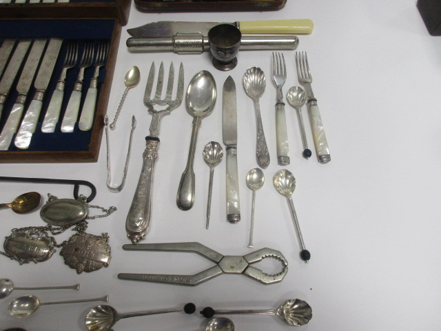 Lot 2 - A set of six 1950s silver teaspoons, Sheffield 1953, together with a set of six silver plated fish