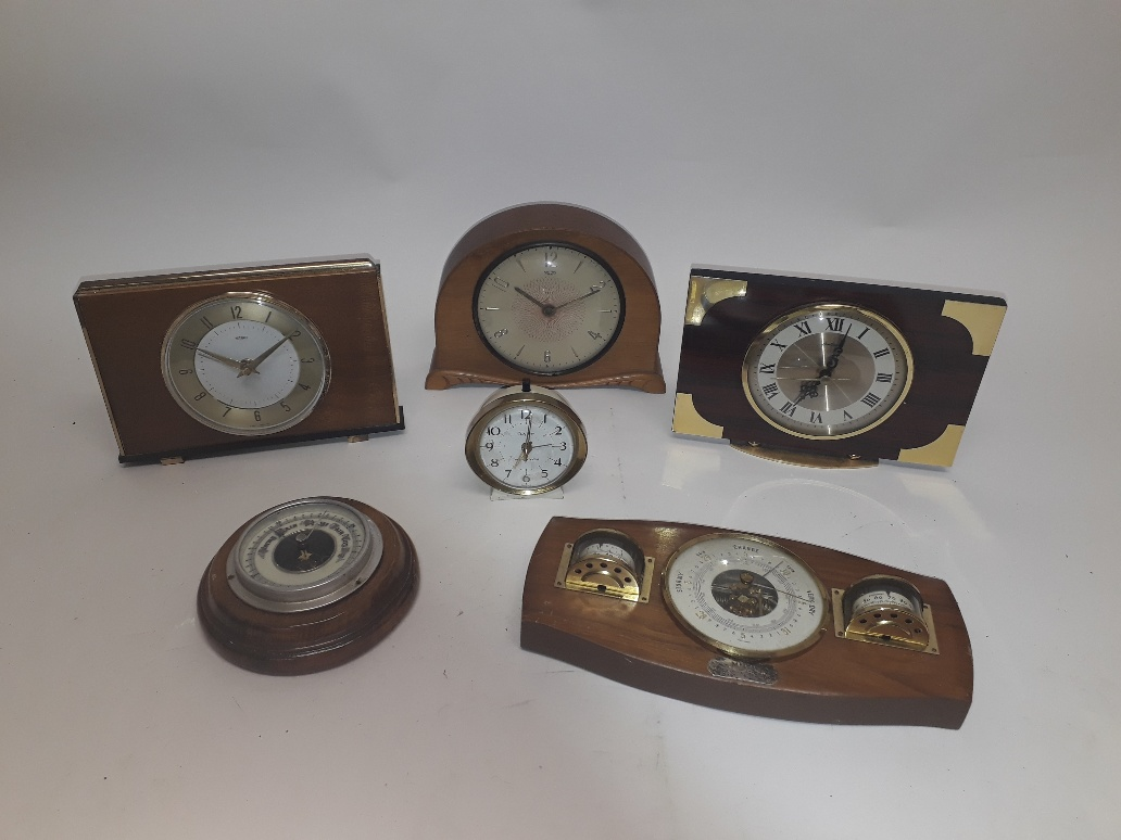 Lot 180 - 1930s and Later Clocks and Barometers, two wall hanging aneroid barometers one circular with