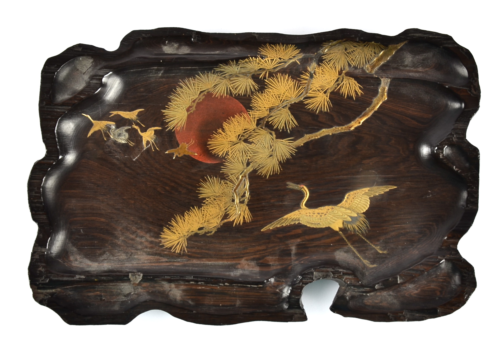 Lot 218 - A Japanese hardwood lacquered panel, the naturalistic shaped plaque decorated with lacquered