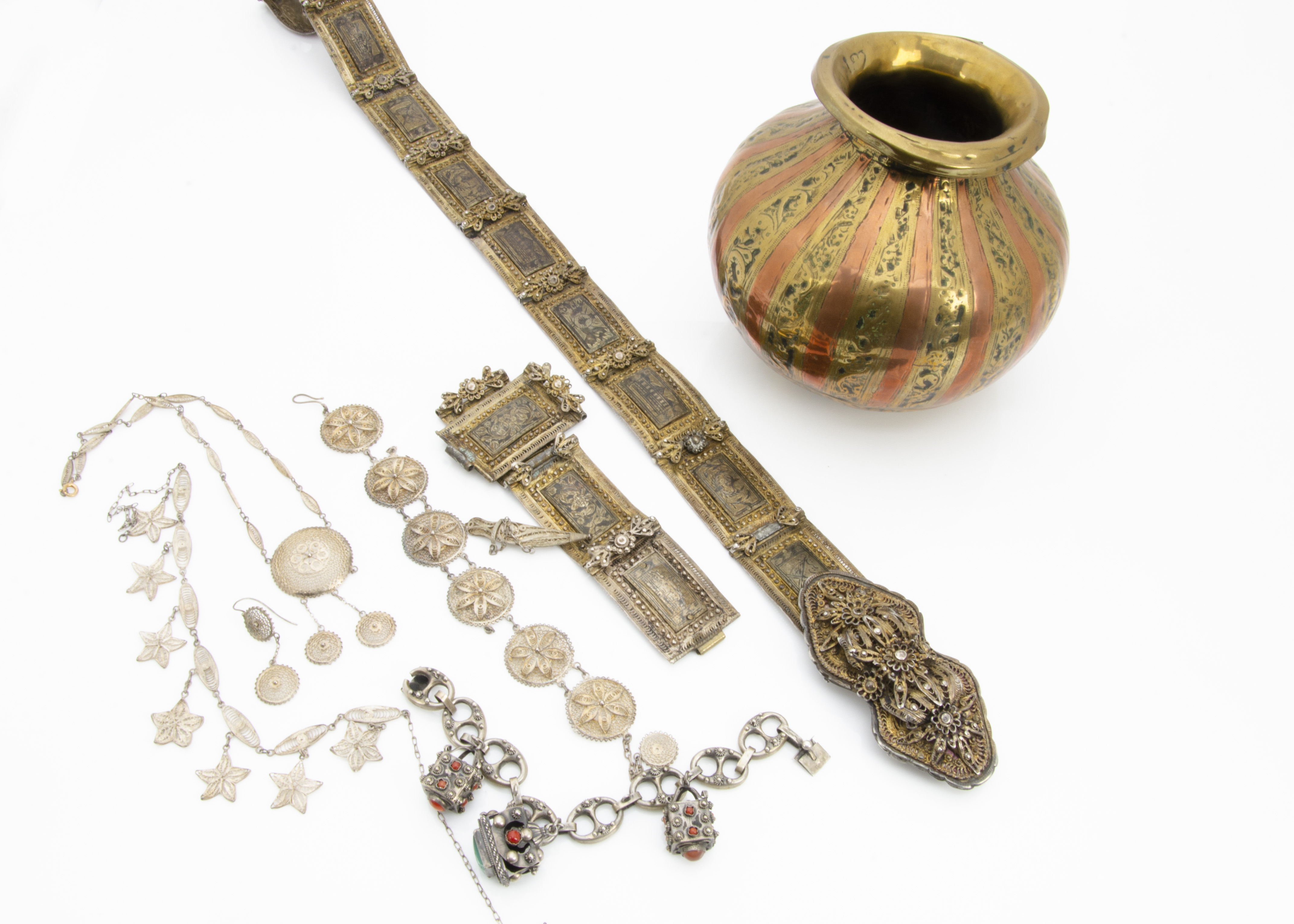 Lot 268 - A collection of Middle Eastern and Egyptian jewels, including a silver and silver gilt niello work