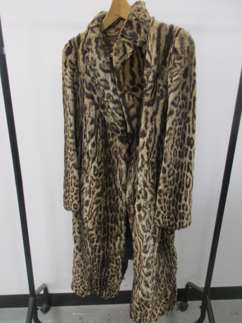 Lot 134 - A ladies 1930s vintage snow leopard fur coat, by Olive, with brown silk lining, length 110cm