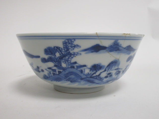 Lot 198 - A 19th Century Chinese blue and white dish, four character mark to base suggests Xianfeng, decorated
