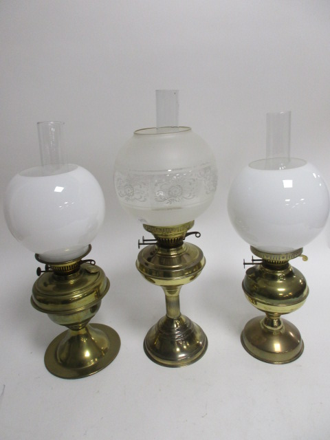 Lot 59 - Three early 20th Century brass oil lamps, one a Duplex marked example, another by Sherwoods of