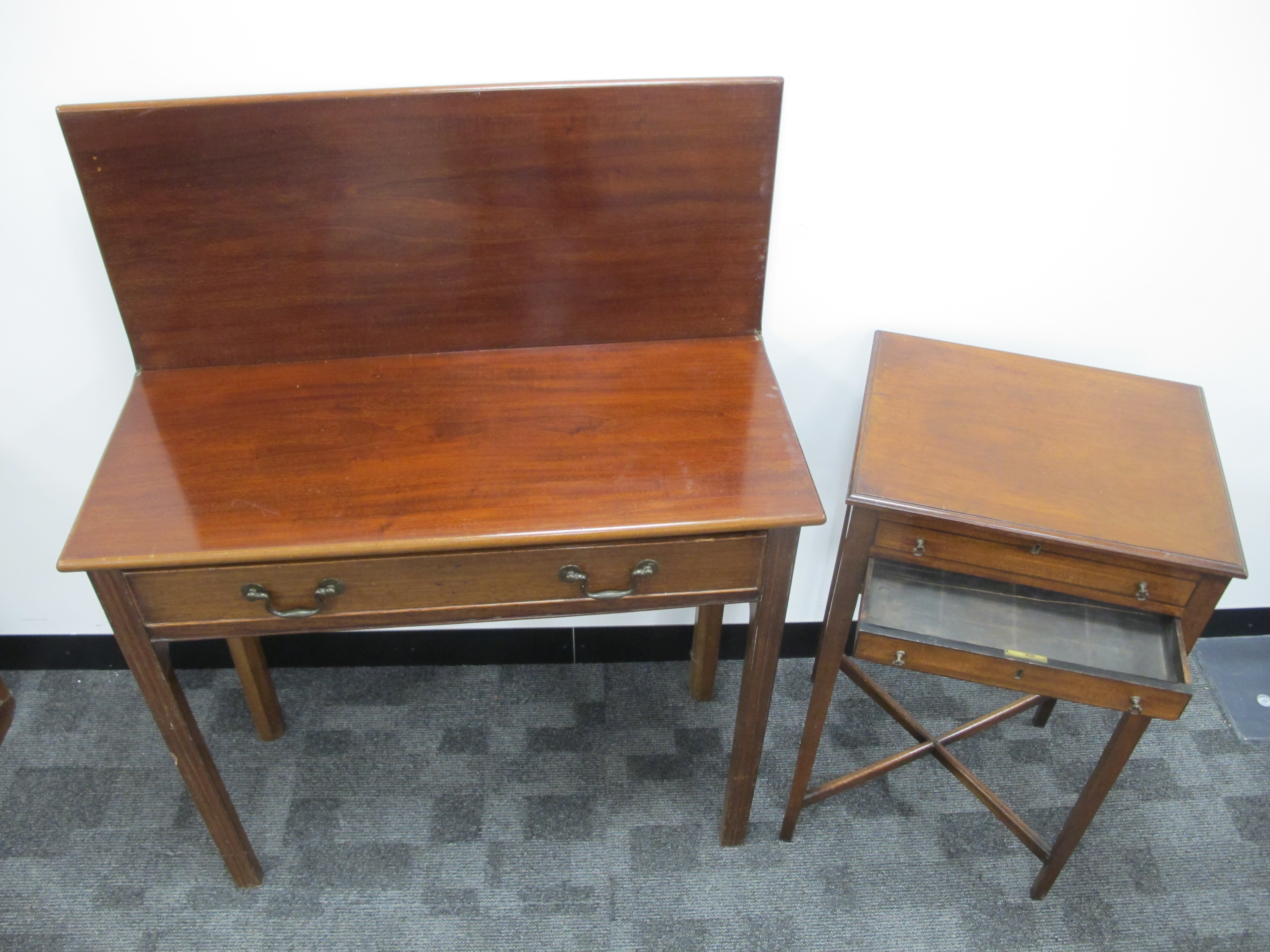 Lot 450 - A 19th Century mahogany work table, with hinged rising flap, one long and one dummy drawer, plus two