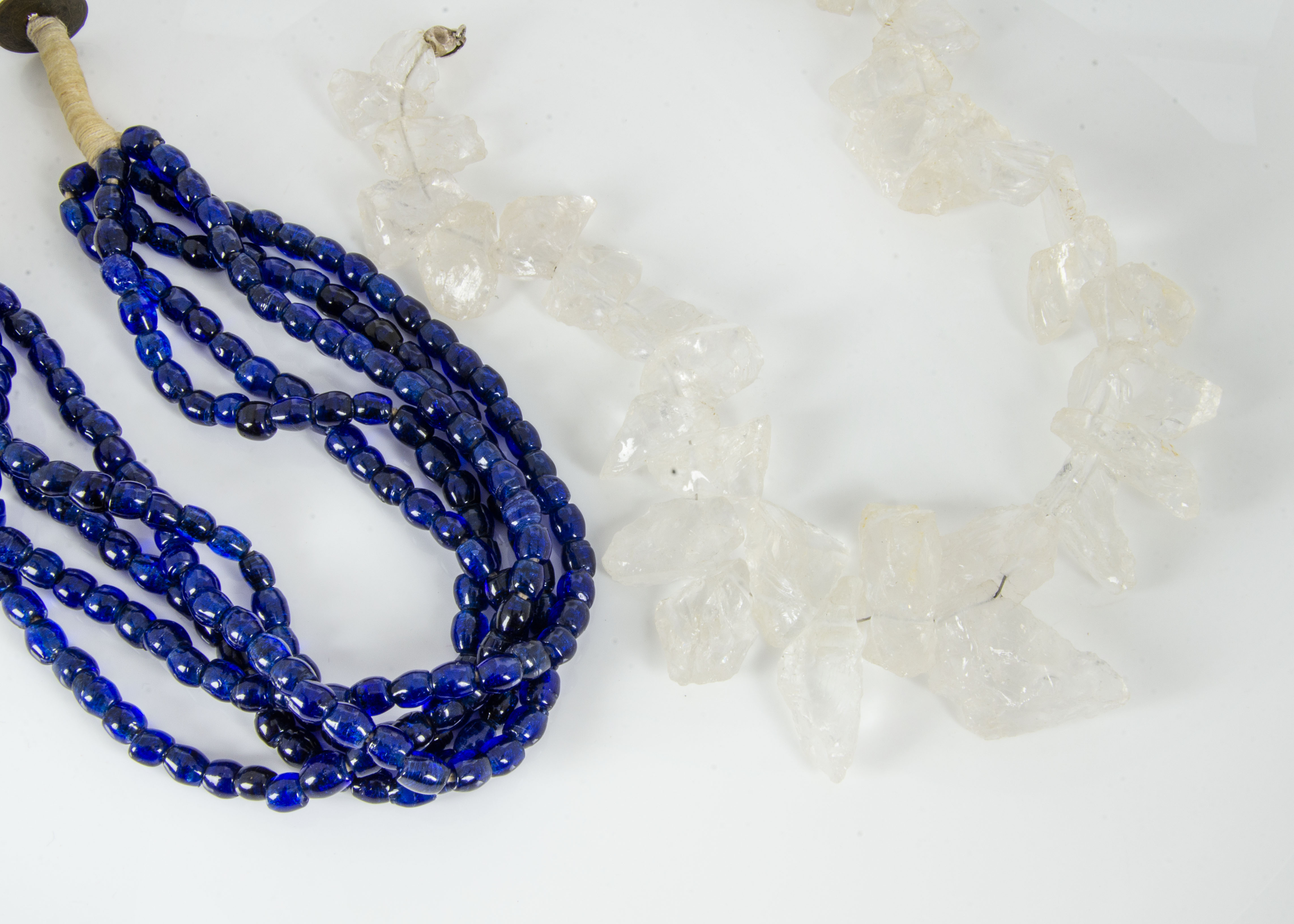 Lot 253 - A large contemporary rock crystal necklace, with silver snap clasp, 51cm and a blue glass bead multi