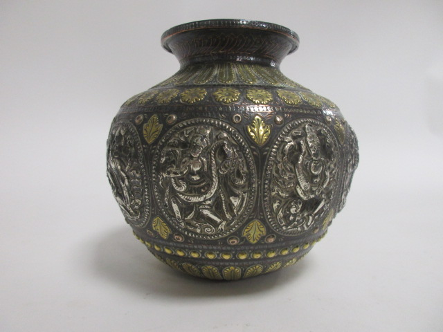 Lot 208 - An Indian metalwork pot, having brass and silver colouring, with multiple cartouches of deities,