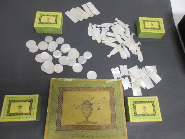 Lot 147 - A collection of 19th Century mother of pearl gaming counters, in several shapes, including fish,