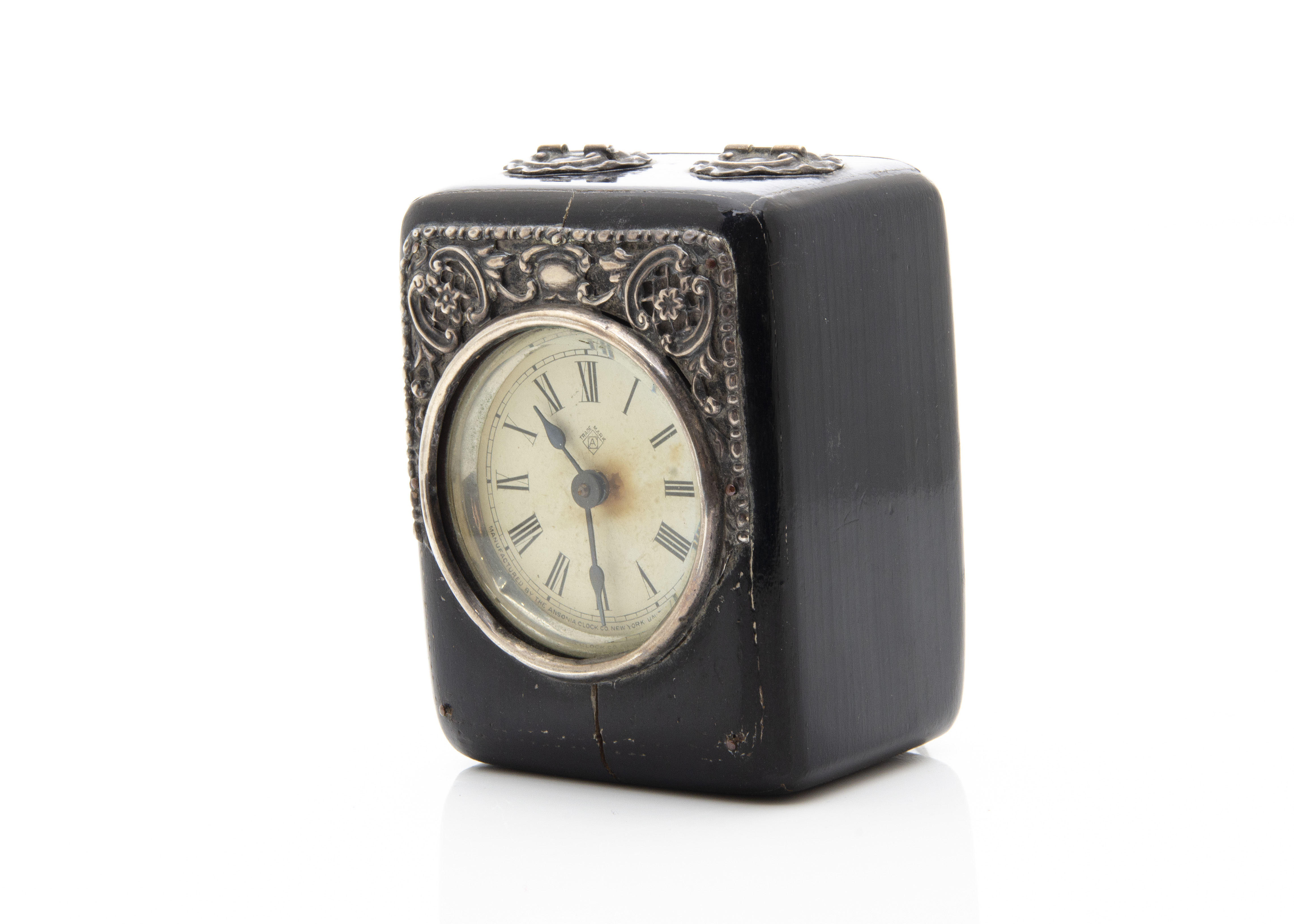 Lot 261 - An American travel clock, the ebonised case with silver mounts, damaged to lower front, crack to