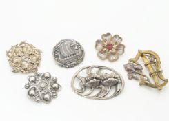 A collection of Art Nouveau and Art Nouveau style brooches, including a Norwegian example of a