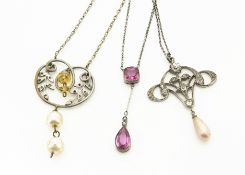 An Art Nouveau style paste set pendant, with simulated pearl drop, another similar and a drop