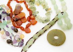 A large collection of rock crystal, amethyst, citrine and hardstone necklaces, pendants and beads,