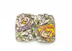 An early 20th Century white metal and enamel belt buckle, with orange and mauve enamel decorated