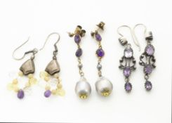 A pair of amethyst and baroque pearl drop earrings, the rose cut amethysts supporting oval baroque