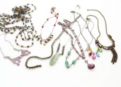 A collection of early 20th Century and later paste set necklaces, including gilt metal enamel floral
