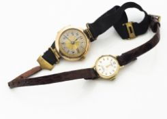 An early 20th Century 9ct gold lady's trench watch, with engine turned face, black enamel Roman