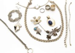 A collection of white metal and silver jewellery, including a Mexican and tiger's eye pin brooch,