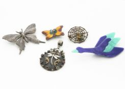 A collection of mixed media insect and animal pendants and brooches, comprising a Lea Stein goose