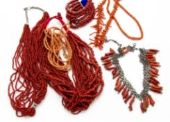 A collection of coral jewellery, including a Middle Eastern white metal and coral fringe necklace, a