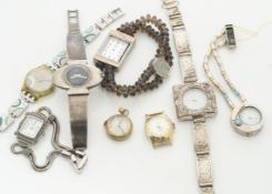 A collection of various ladies wristwatches, including a silver elliptical cased and strap