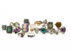 A collection of silver gem set dress rings, including tiger's eye, citrine, turquoise, synthetic