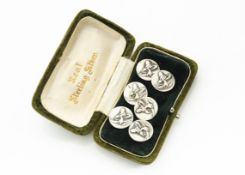 A set of six continental Art Nouveau white metal circular buttons, with stylised irises in relief