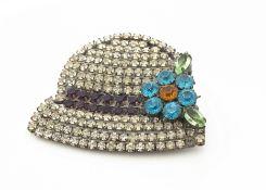 An Art Deco paste set brooch, modelled as a bonnet with floral bow, 6cm x 5cm