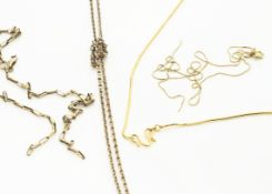 An opera length oval linked gilt metal chain, with snap clasp together with two gold necklaces (af),