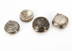 A French Art Nouveau white metal miniature hinged circular box, with embossed decoration of poppy