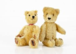 A small Schuco 1950s yes/no teddy bear, with golden mohair, clear and black glass eyes with brown