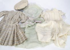 Four large doll's dresses, a cotton broderie Anglaise drop-waisted dress with puffed sleeves --20in.