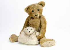 An antique style teddy bear, with exaggerated features, old large boot button eyes, antique leather,