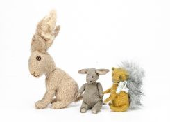 Three artist made animals, a grey artificial silk plush seated donkey with swivel head --5½in. (
