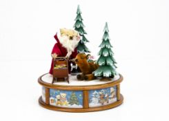 A Steiff limited edition Christmas musical box 2003, 249 of 1000 --10 ½in. (27cm.) high (missing box