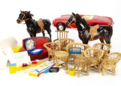 Pedigree Sindy accessories, a red sports card, two horses, two settees, two armchairs and other