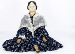 A very large papier-mâché Grenier type shoulder-head doll, with blue painted eyes, black painted