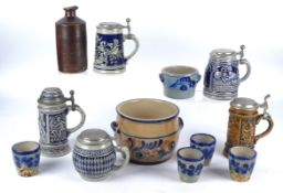 A small group of German salt glazed stonewares, to include pewter mounted steins, pots, cups, and