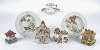 Four 19th Century and later Staffordshire style models of cottages, the largest a money box and 15cm