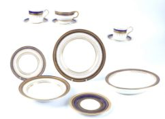A Royal Doulton bone china part dinner service, with gilt blue decoration, to include cups, saucers,