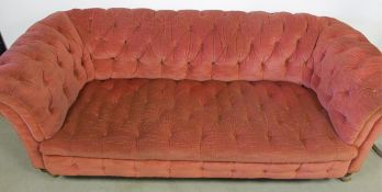 A button back Chesterfield sofa, upholstered in rose fabric, with gold braiding, with replacement