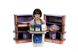 A Camel Turkish Blends shop display, with a pin-up girl holding a tray with three varieties of
