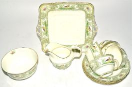 A twelve piece early 20th Century tea set by Faisan Radfordian, the moulded china with transfer
