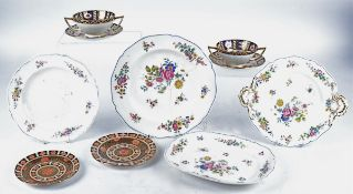 Four Minton china twin handled soup cups and saucers in the Imari taste, together with two similar