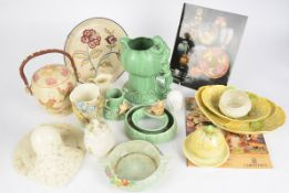 An early 20th Century Clarice Cliff part dinner service with transfer printed design, together