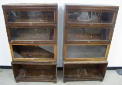 A pair of Globe Wernicke four section bookcases, open base, three glazed sections and a fitted