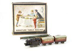 Bing Table Top 00 Gauge clockwork Passenger Train Set, comprising lined red, black 2-4-0 Tank (lacks